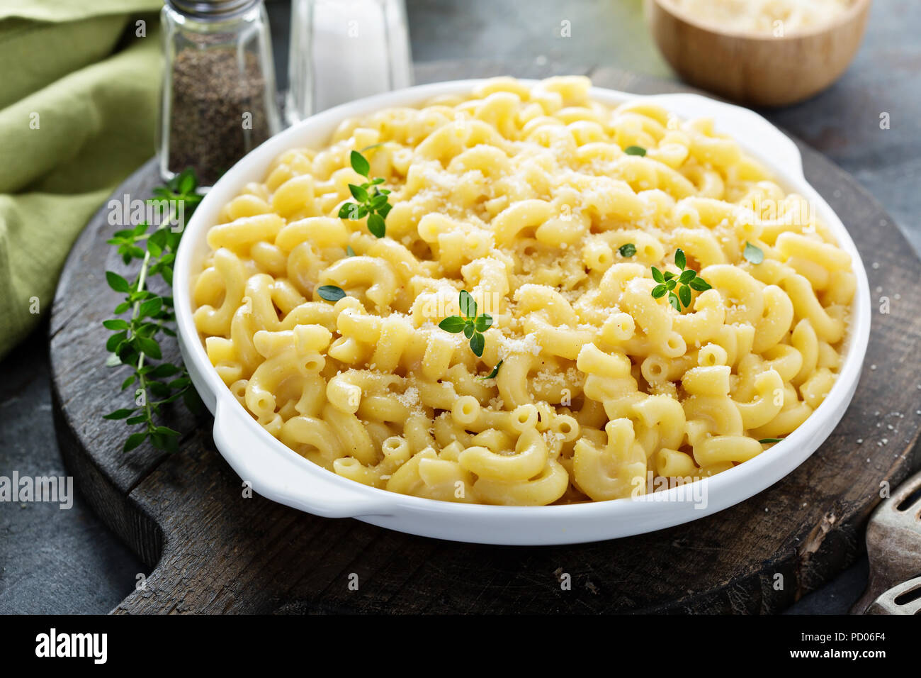 Macaroni and cheese on a white plate - Stock Image