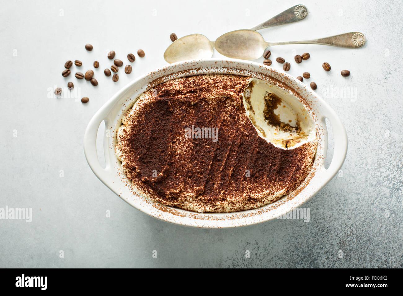 Tiramisu cake in a ceramic dish - Stock Image
