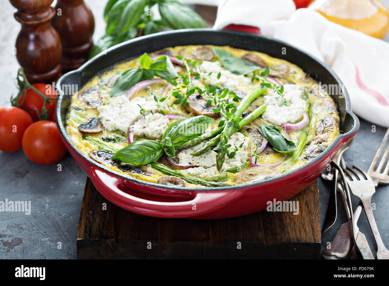 Asparagus, mushrooms and goat cheese frittata - Stock Image