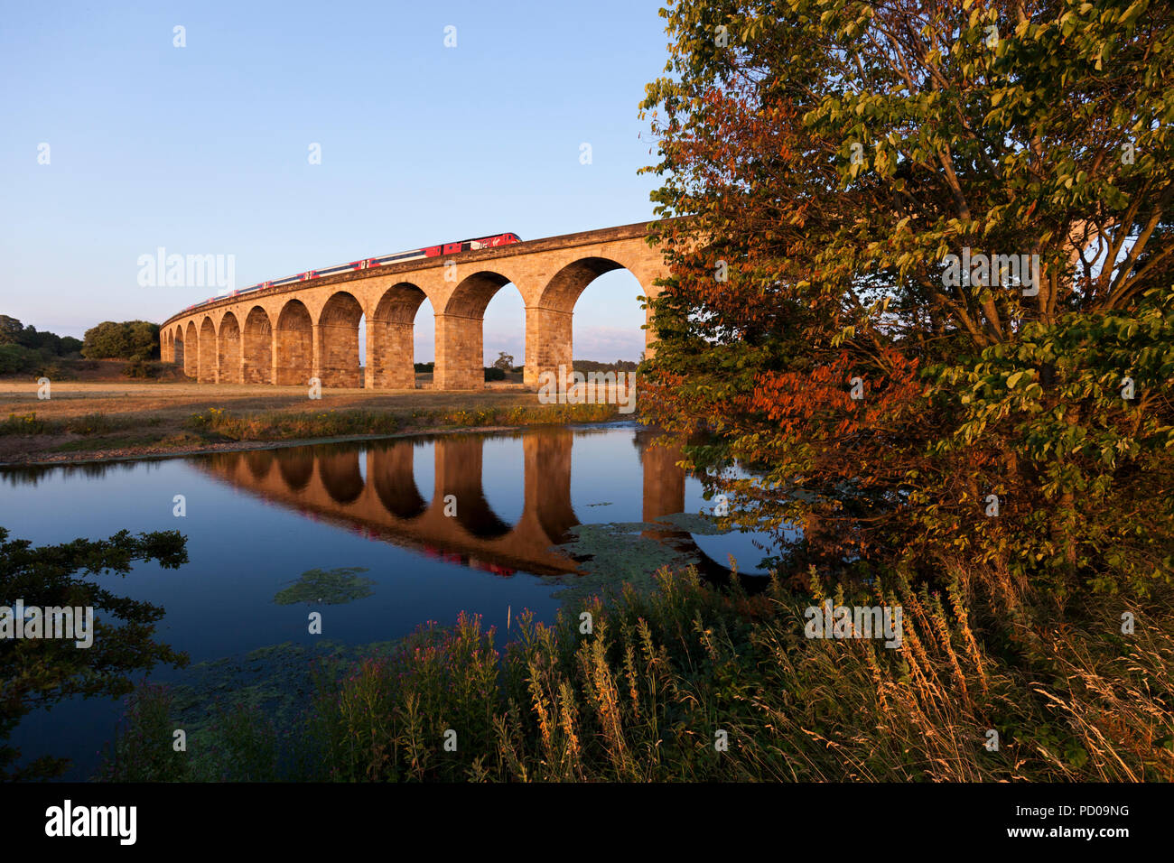A LNER High speed train ( intercity 125 ) still carrying Virgin logos crossing  Wharfedale viaduct on the line to Harrogate - Stock Image