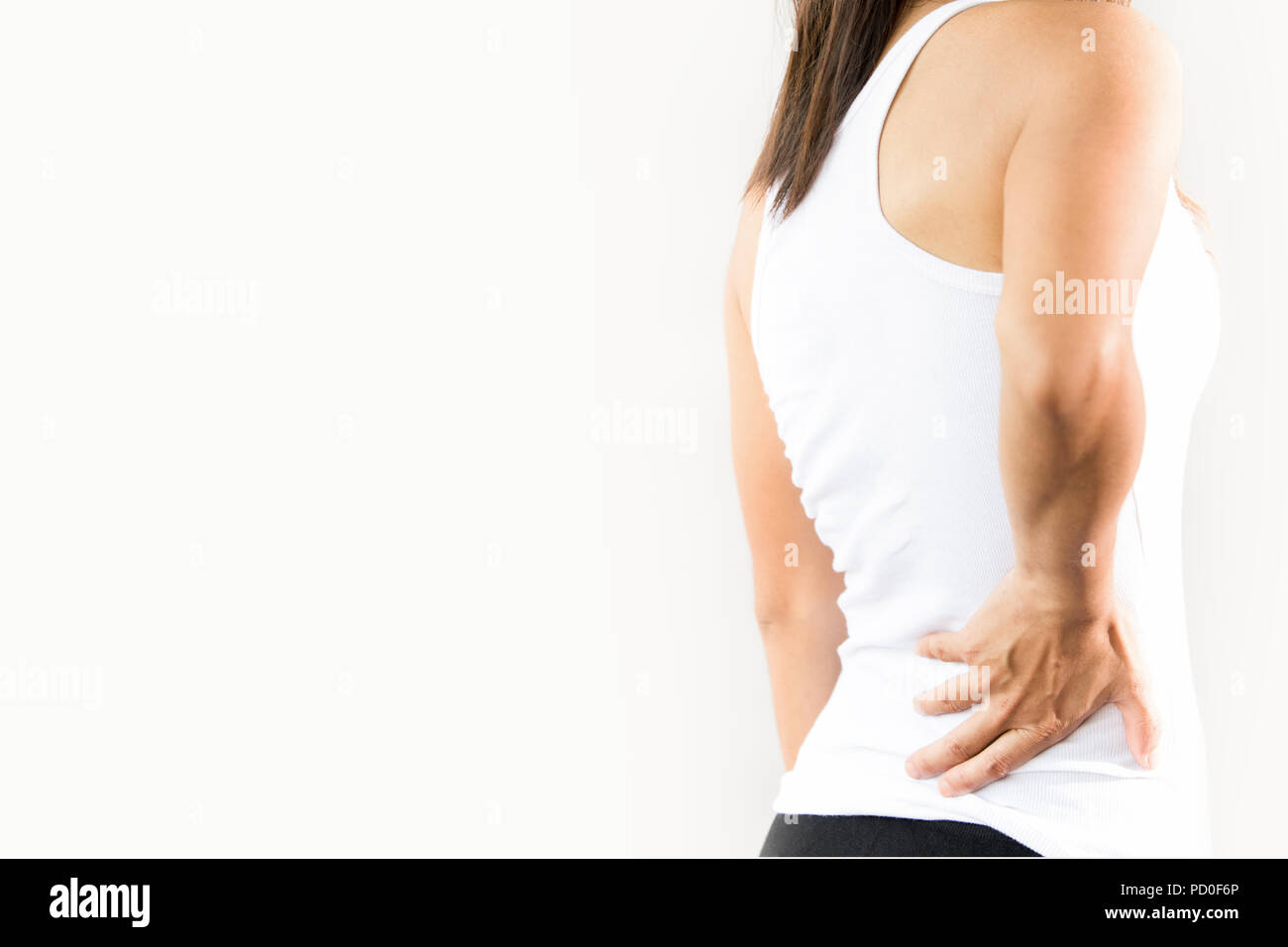 woman palpation at lower back, low back pain in young woman Stock Photo