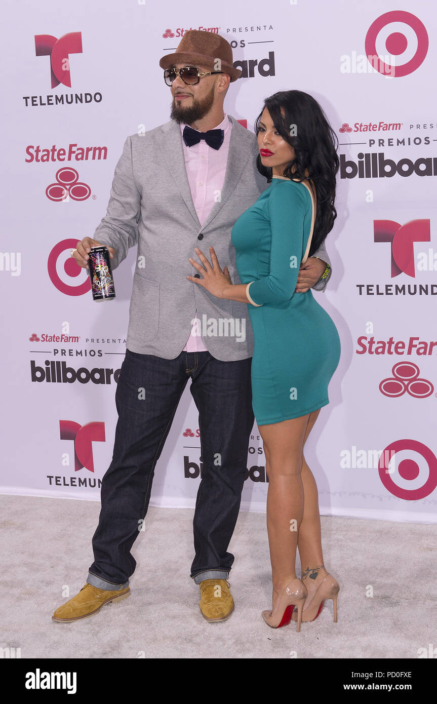 MIAMI, FL - April 30: Don Dinero and Luna Star arrives at The 2015 Billboard Latin Music Awards at the BankUnited Center on the University of Miami Campus on April 30, 2015 in Miami Florida   People:  Don Dinero and Luna Star - Stock Image