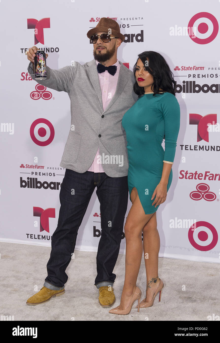MIAMI, FL - APRIL 30:  Don Dinero and Luna Star arrives at 2015 Billboard Latin Music Awards presented by State Farm on Telemundo at Bank United Center on April 30, 2015 in Miami, Florida   People:  Don Dinero and Luna Star - Stock Image