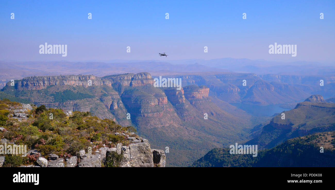 South Africa, a fantastic travel destination to experience third and first world together. Drone hovering over Blyderiver Canyon in Mpumalanga. - Stock Image
