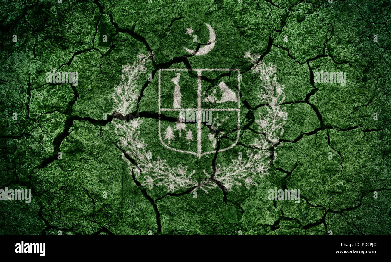 Gilgit-Baltistan, administrative territory in Pakistan, flag on dry earth ground texture background - Stock Image