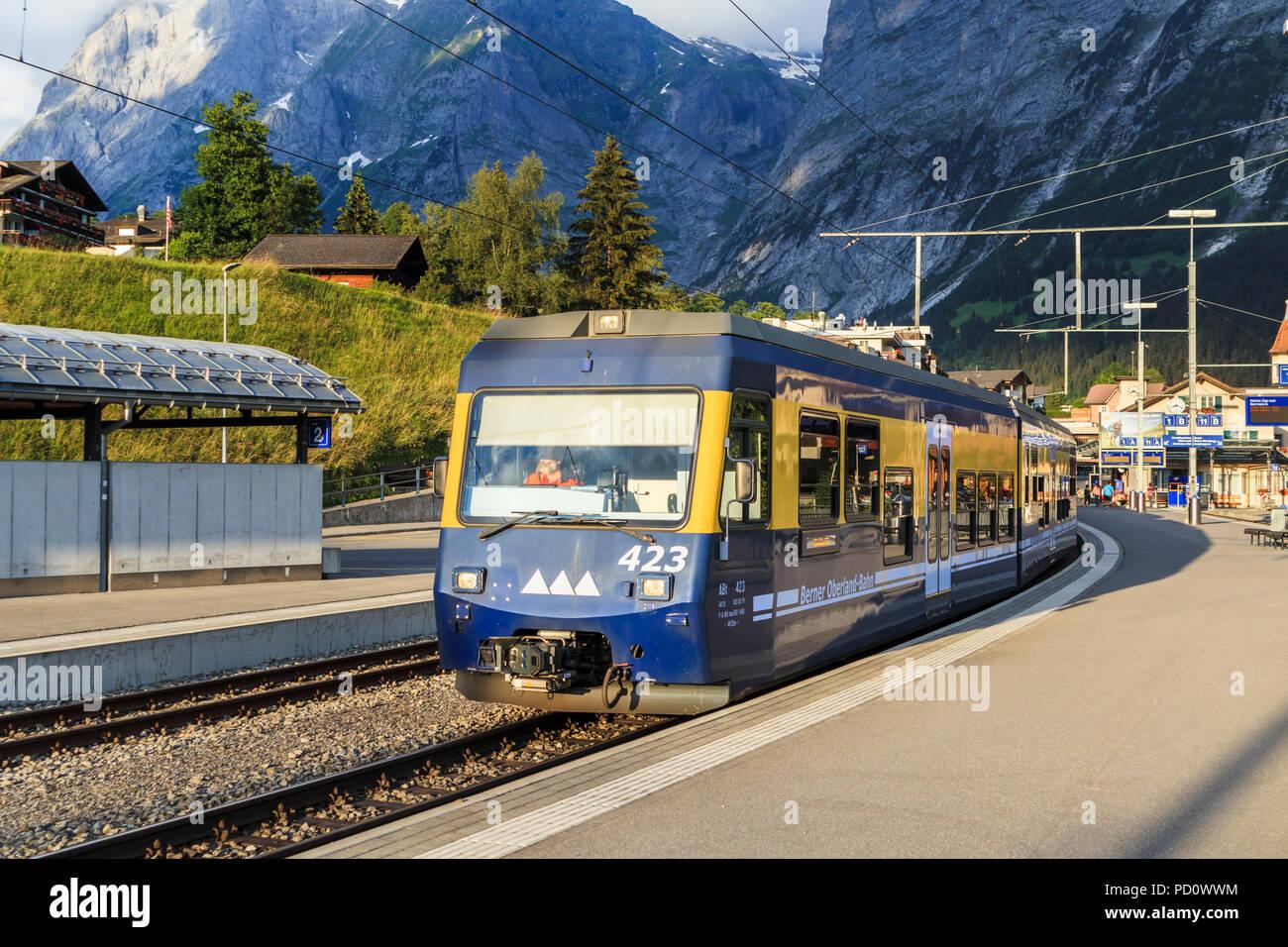Berner Oberland Bahn (Bernese Oberland Railway) train to Interlaken Ost in Grindelwald station, Bernese Oberland, Switzerland - Stock Image