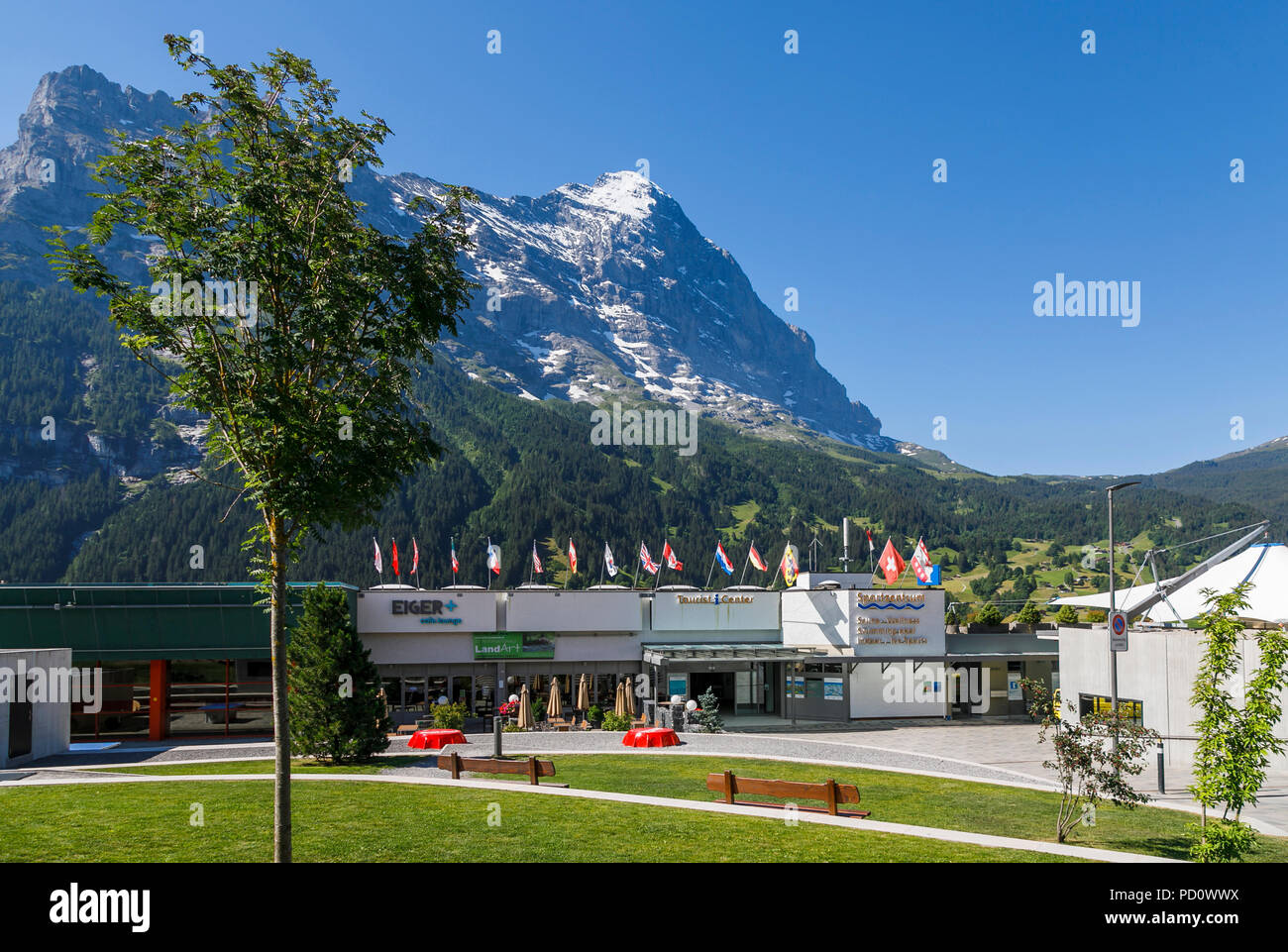 The Sportzentrum (sports centre) and Tourist Infomation Center in Grindelwald, the Eiger mountain in the background, Bernese Oblerland, Switzerland - Stock Image
