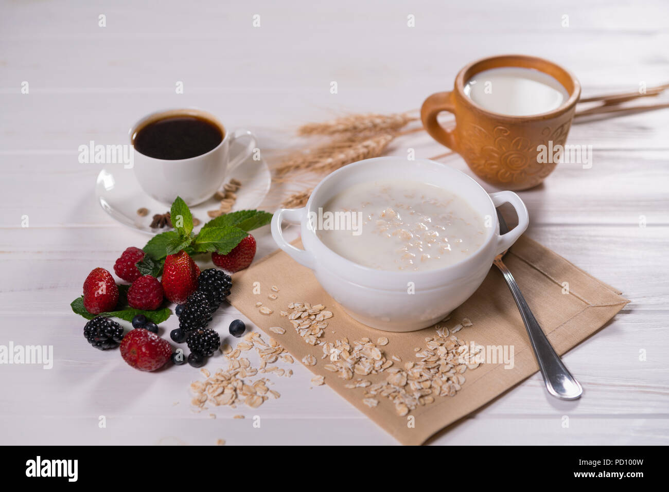 Oatmeal Porridge With Fruits And Cup Of Coffee On Breakfast Table Stock Photo Alamy