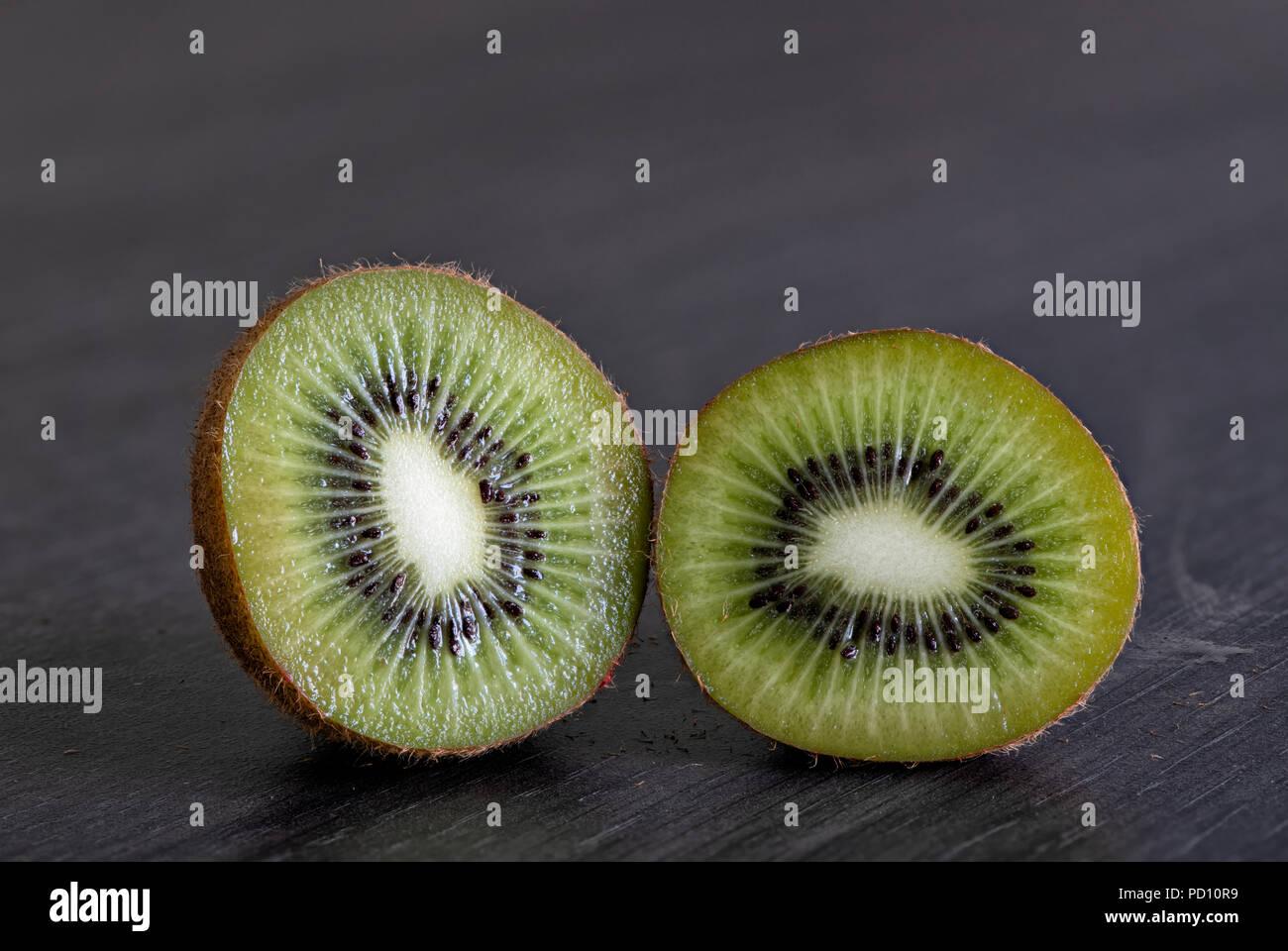 Luscious fresh Kiwi Fruit on a grey kitchen worktop - Stock Image