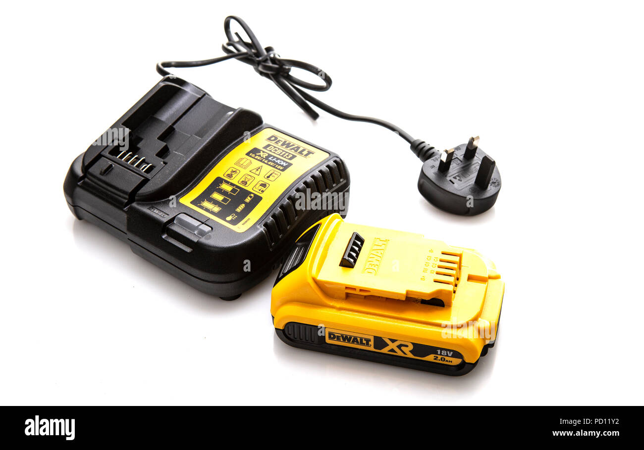SWINDON, UK - AUGUST 5, 2018: DeWalt DCB113 cordless power tool battery charger and battery on a white background - Stock Image