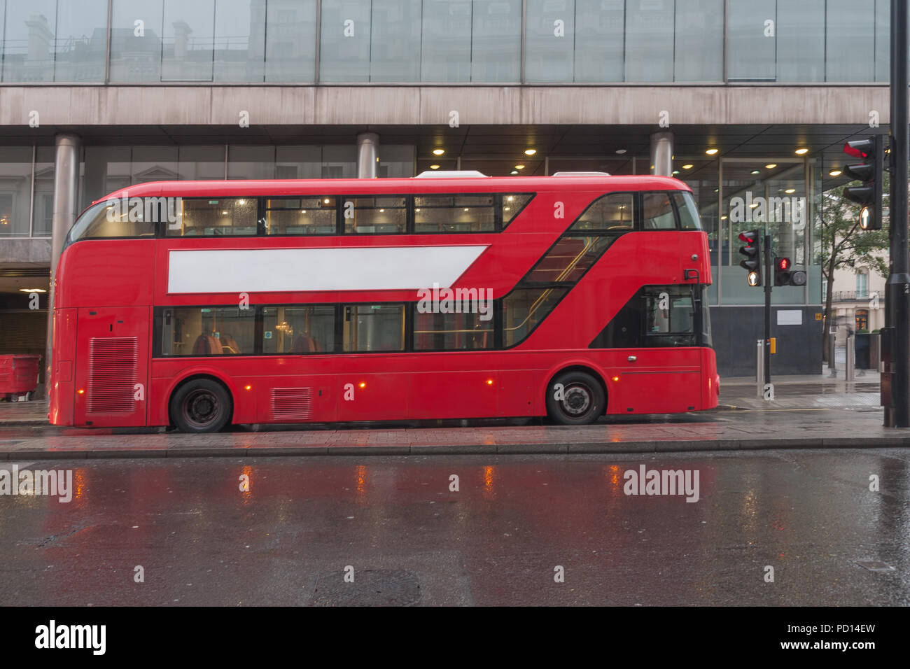 Public traffic, red double decker bus on Pall Mall street  in London, United Kingdom - Stock Image