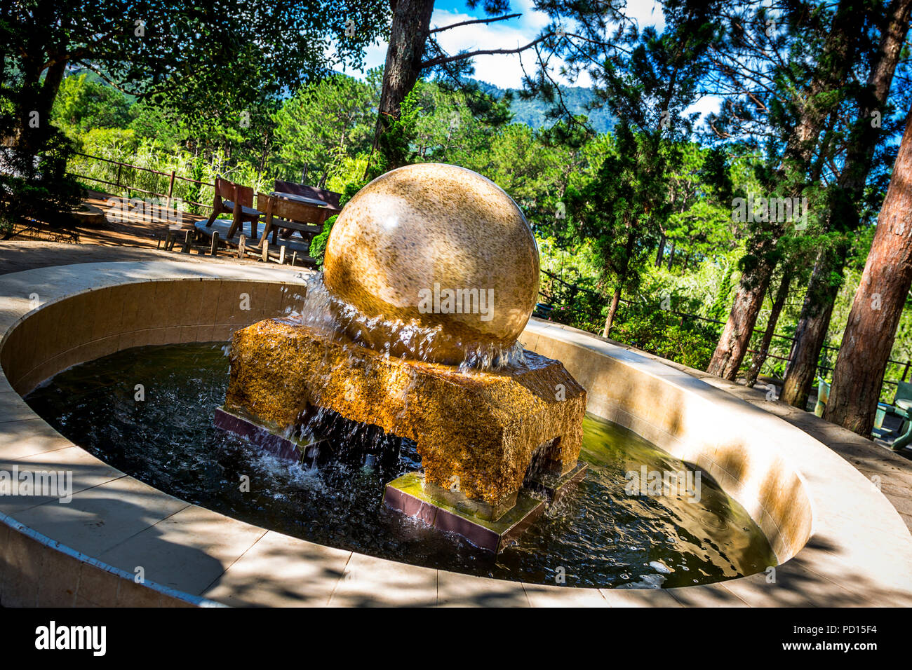 Marble fountain at the end of the cable car ride in Da Lat, Vietnam. This is at the garden at the Buddhist Temple, Chia Truc Lam. - Stock Image