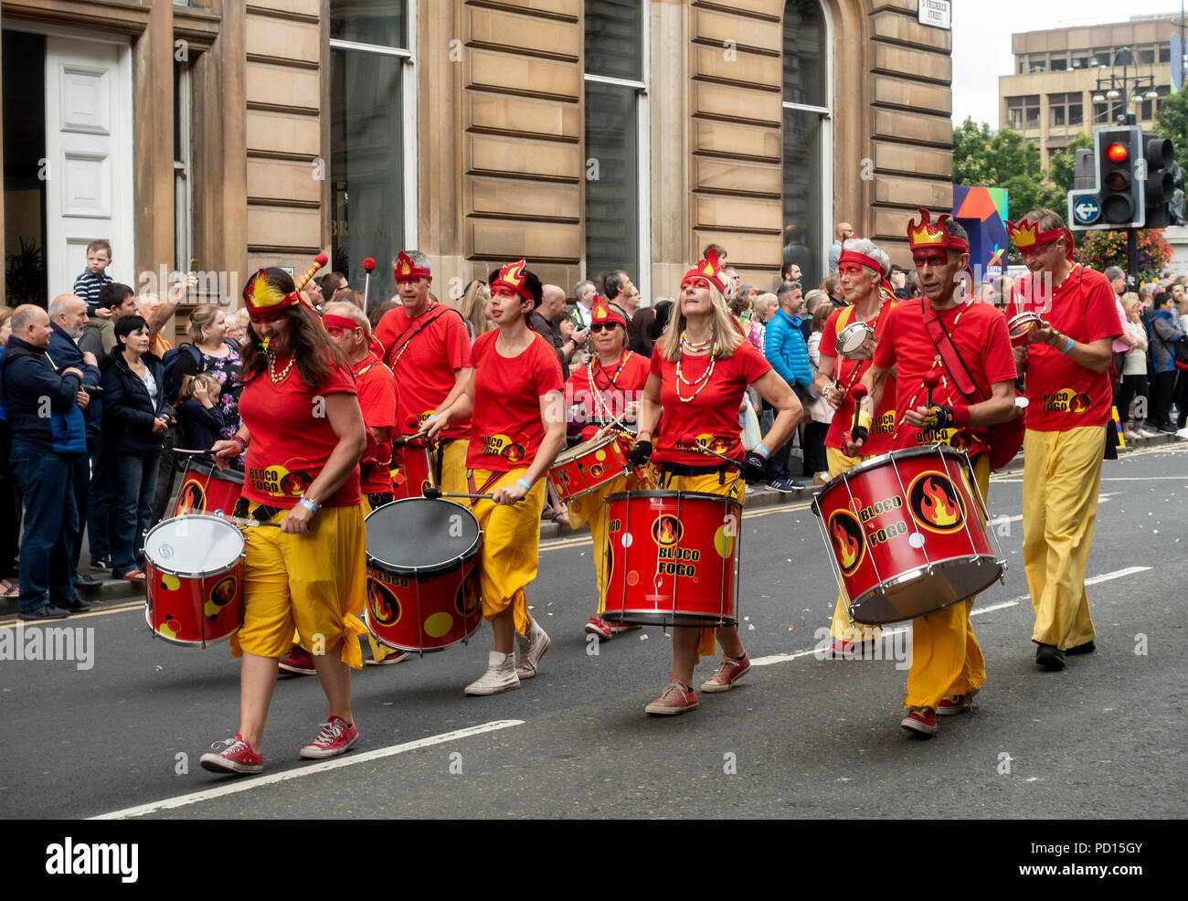 Samba band Bloco Fogo from Kent participating in the Carnival Procession of Glasgow's Merchant City Festival,.2018 - Stock Image