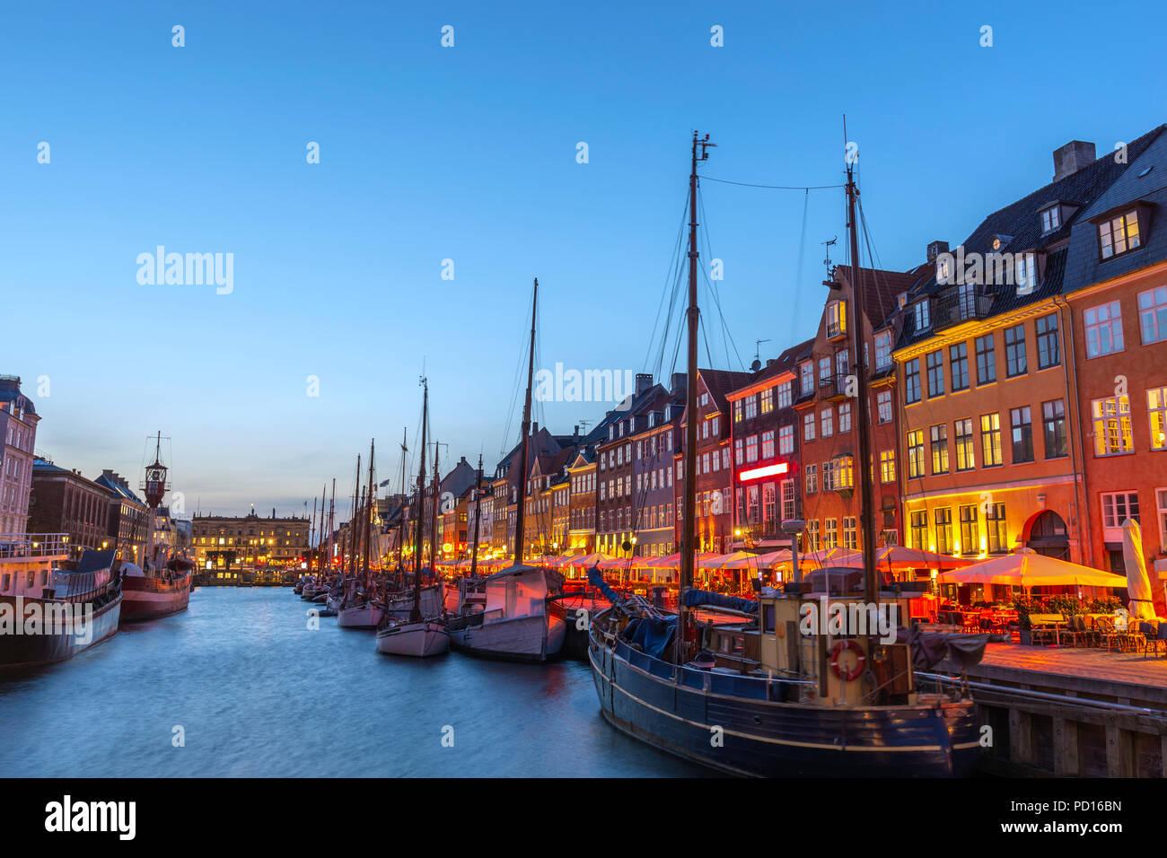 Copenhagen night city skyline at Nyhavn harbour, Copenhagen Denmark - Stock Image