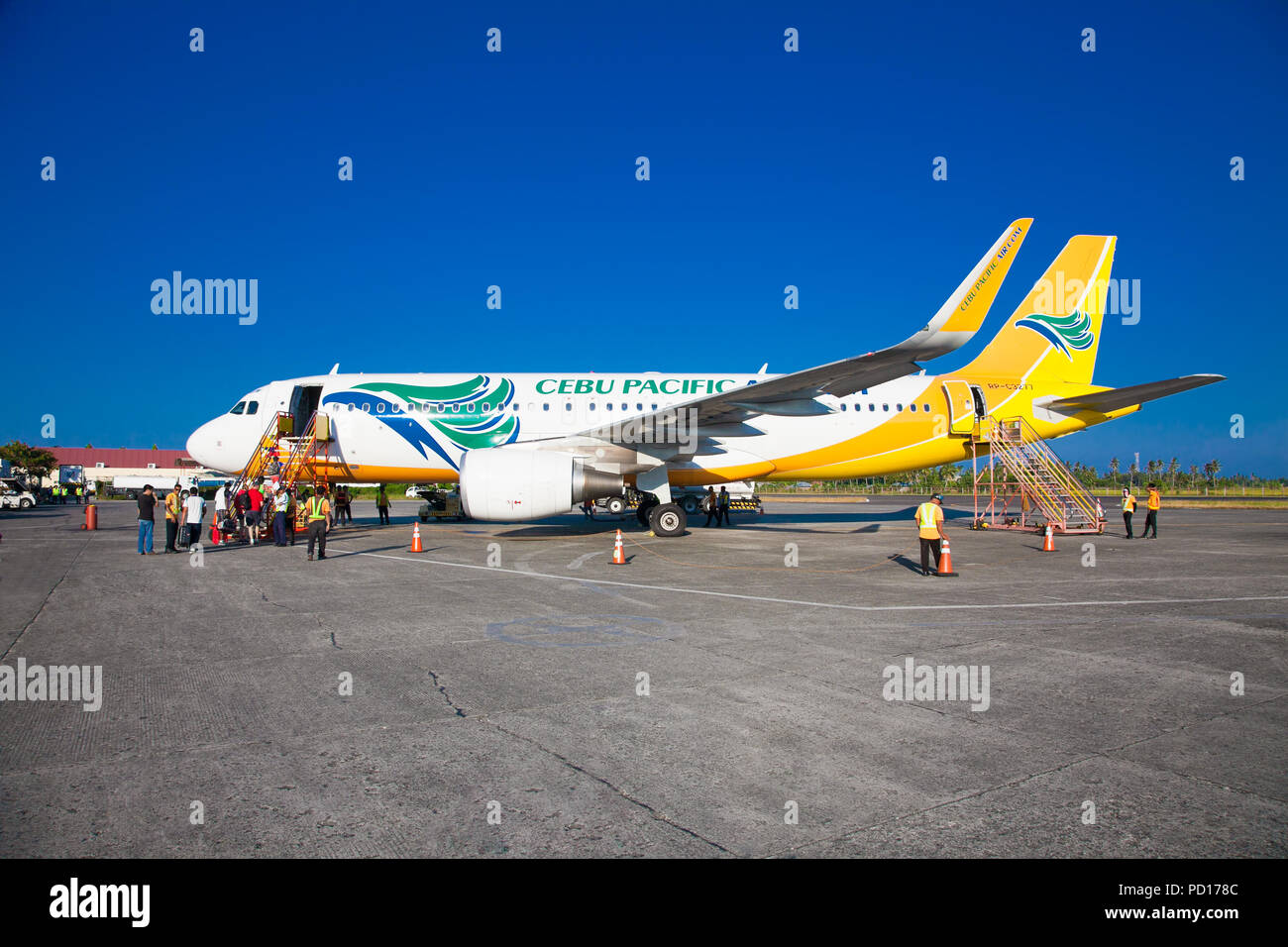 PUERTO PRINCESA PHILIPPINES - MARCH 23. 2016: Tourists embark on the Cebu Pacific aircraft  at Puerto Princesa International Airport on March 23, 2016 - Stock Image