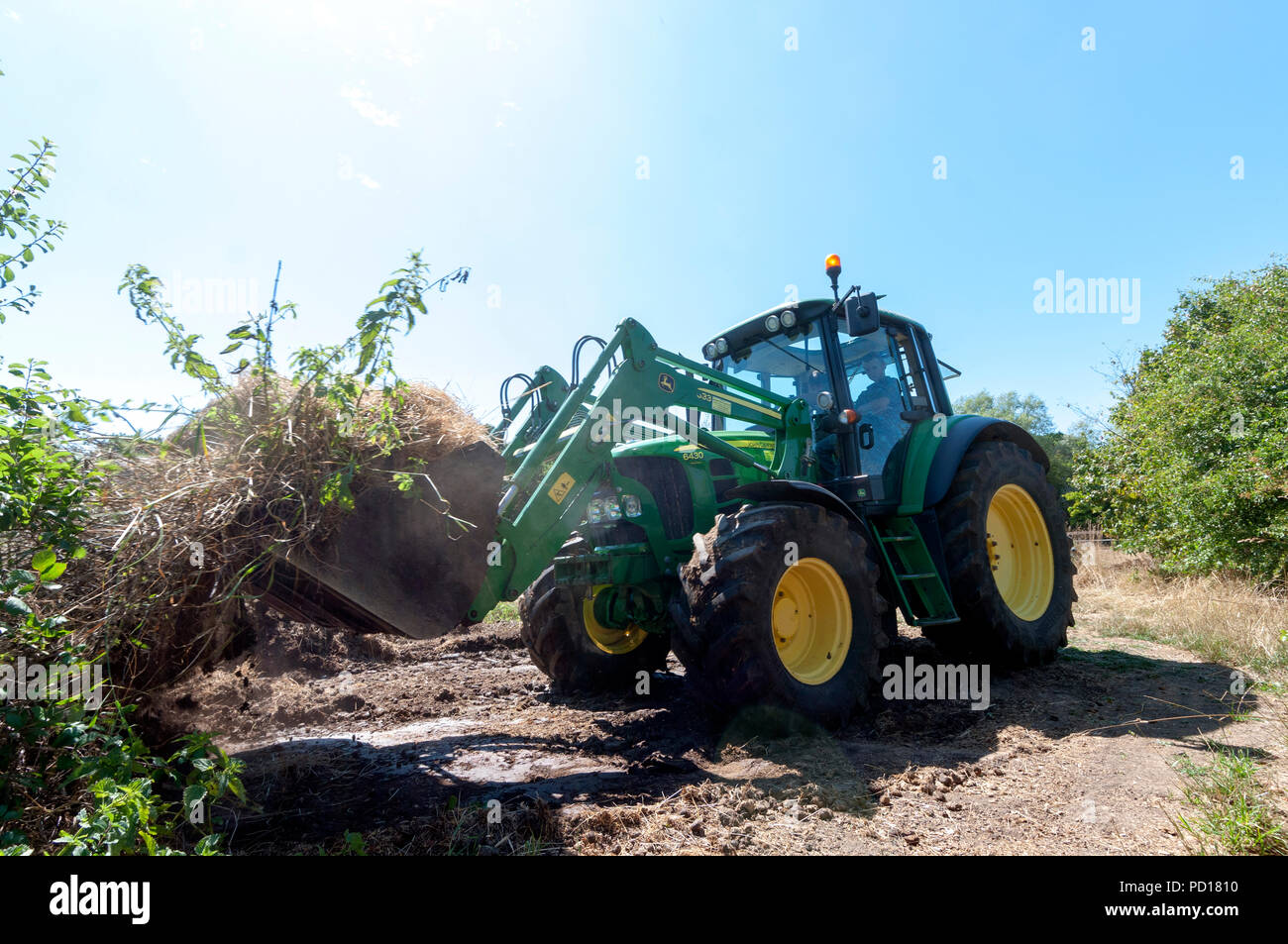 John Deere 6430 Tractor Fitted with JD 633 loader. - Stock Image