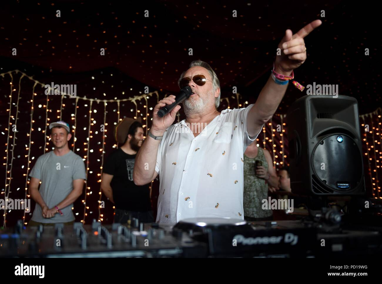 Vic Reeves performs his Reggae Set at the festival at Bestival, Dorset, UK Credit: Finnbarr Webster/Alamy Live News - Stock Image