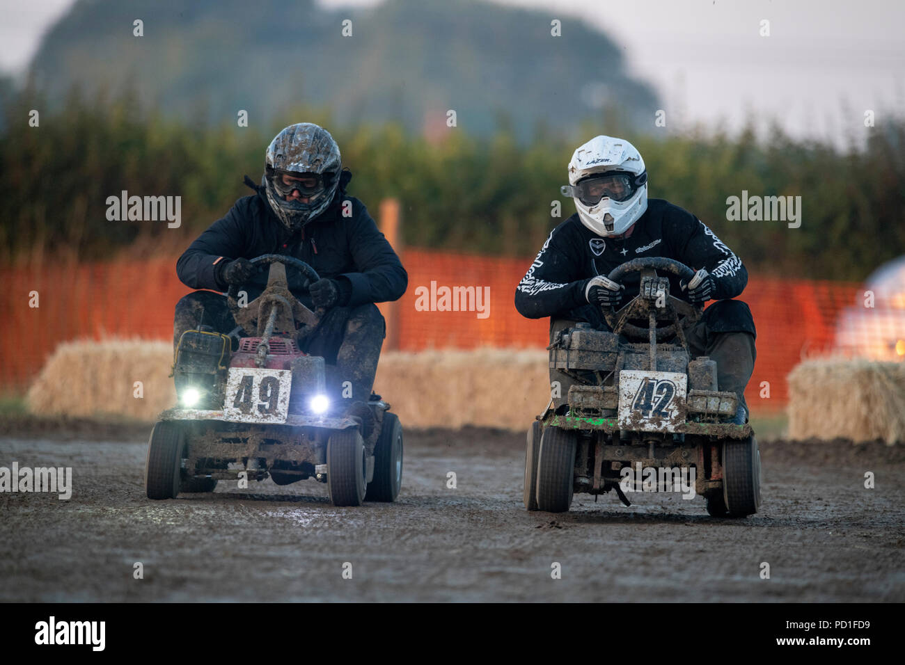 The 12 hour endurance lawnmower race, organised by the British Lawn Mower Racing Association, started at 8pm on Saturday and teams from around the world raced through the night to the finish line at 8am Sunday morning. 5th August 2018. Billingshurst, West Sussex. The 12 hour enduarance lawnmower race, organised by the British Lawn Mower Racing Association, started at 8pm on Saturday and teams from around the world raced through the night to the finish line at 8am Sunday morning. (left and right) Team Mower With Attitude and Mow Fear. At 11 hours and 30 minutes, Northerners Kick Grass wer - Stock Image
