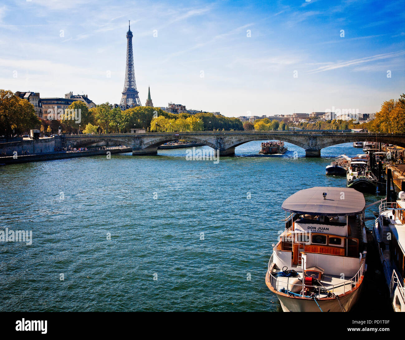 The Eiffel Tower dominates the Paris skyline as seen from the River Seine. - Stock Image