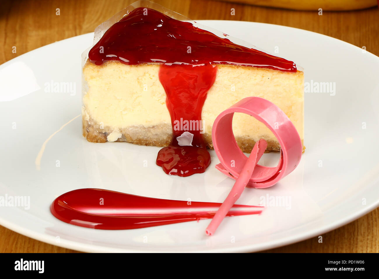 Strawberry cheesecake and coffee cup - Stock Image