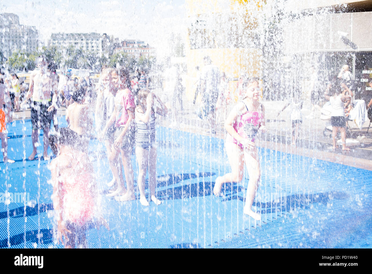 Children have fun and cool off during the summer heat wave in central London Stock Photo