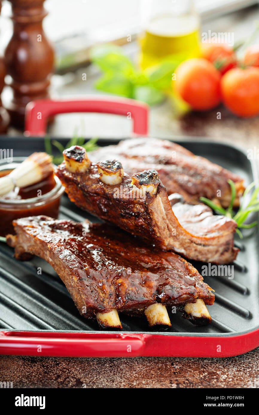 Grilled ribs with barbeque sauce - Stock Image