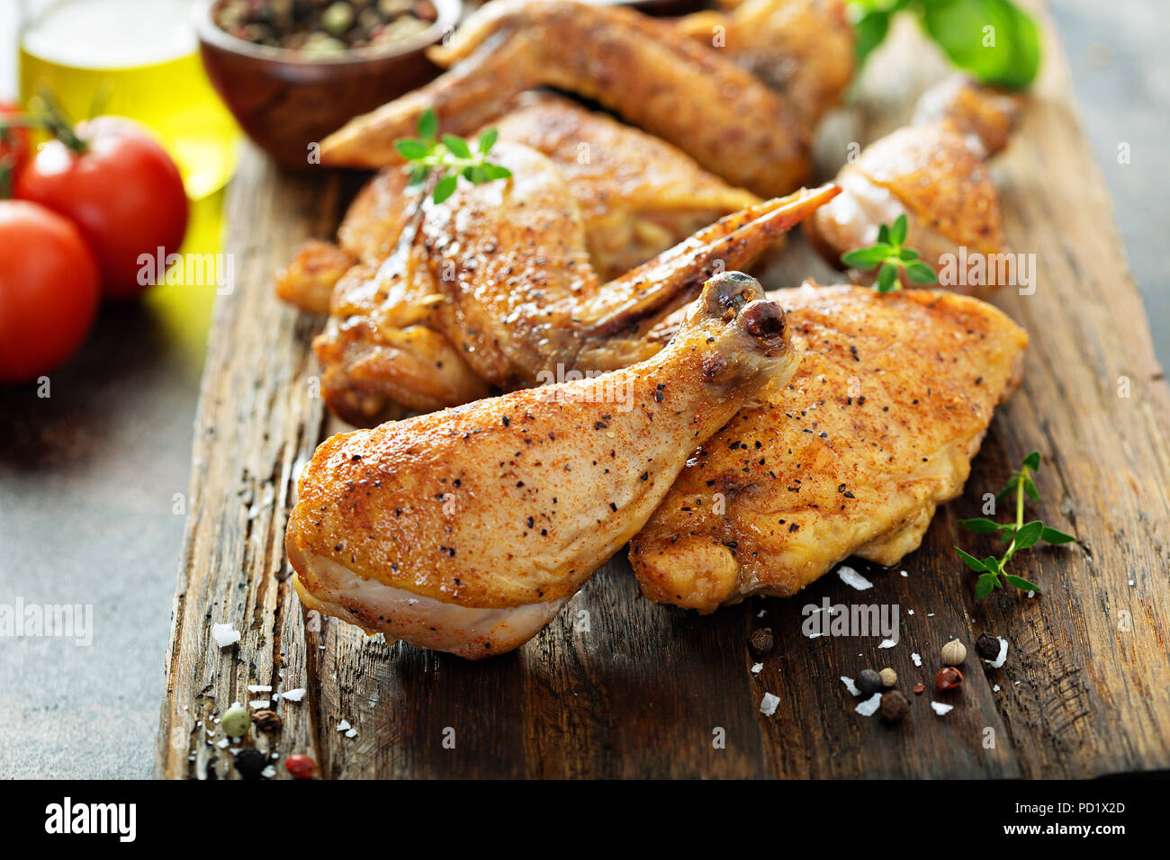 Pieces of grilled or smoked chicken - Stock Image
