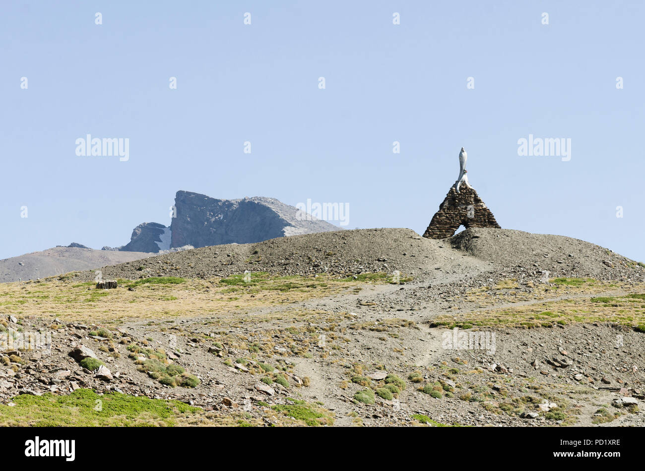 Our Lady of the Snows, Virgen de las Nieves, statue and Pico Veleta summit, Sierra Nevada, in summer season. Granada, Andalusia, Spain. - Stock Image