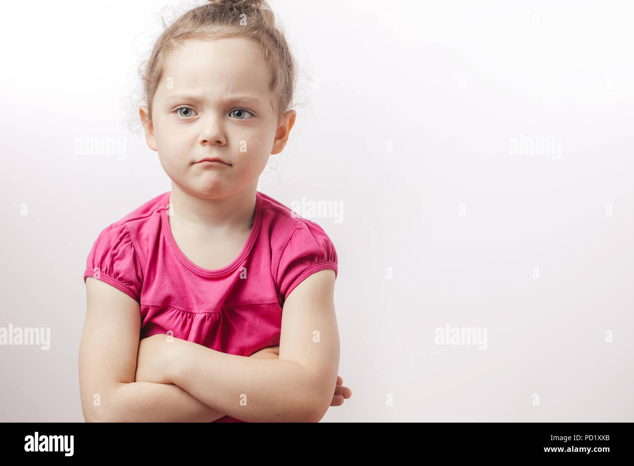 unhappy beautiful ginger girl with crossed arms is expressing disagreement. body language. caprice - Stock Image