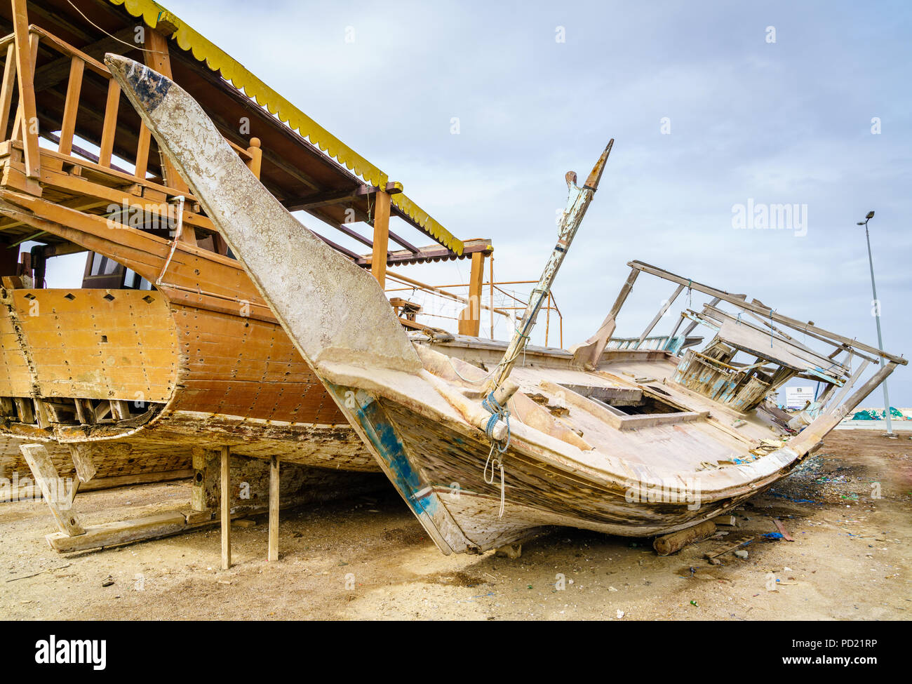 Old destroyed boats on shore near Dibba Port, UAEfishing Stock Photo