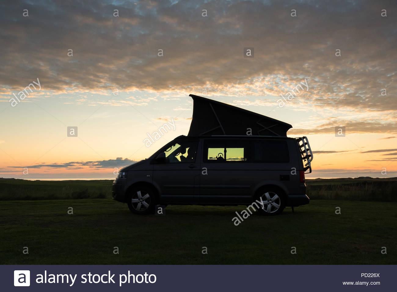 campervan vw  silhouette at sunset, Scotland, UK - Stock Image