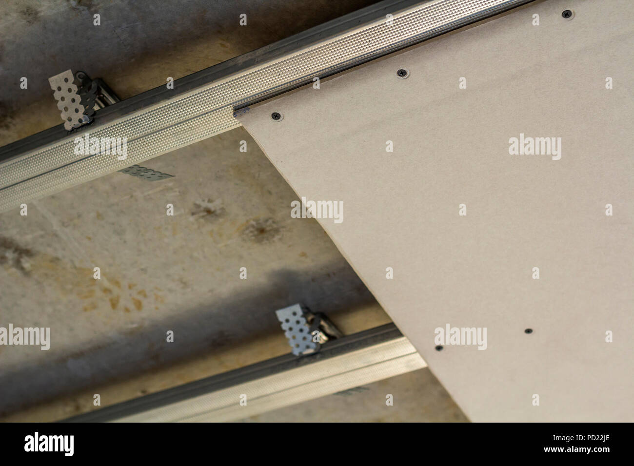 Close-up detail of room under construction. Suspended ceiling from ...