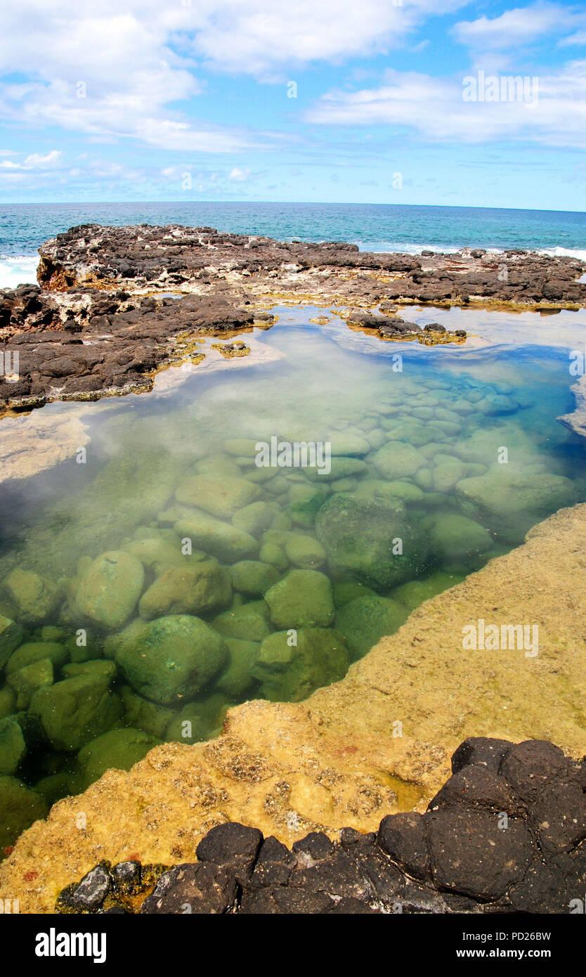 Tidal lagoon at Secret Beach, Kauai, Hawaii Stock Photo