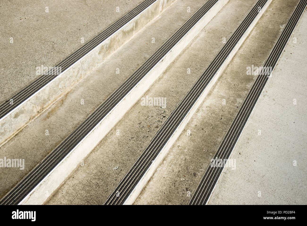 Cement stairs with non-slip extruded aluminum stair nosings for safety and grip. - Stock Image