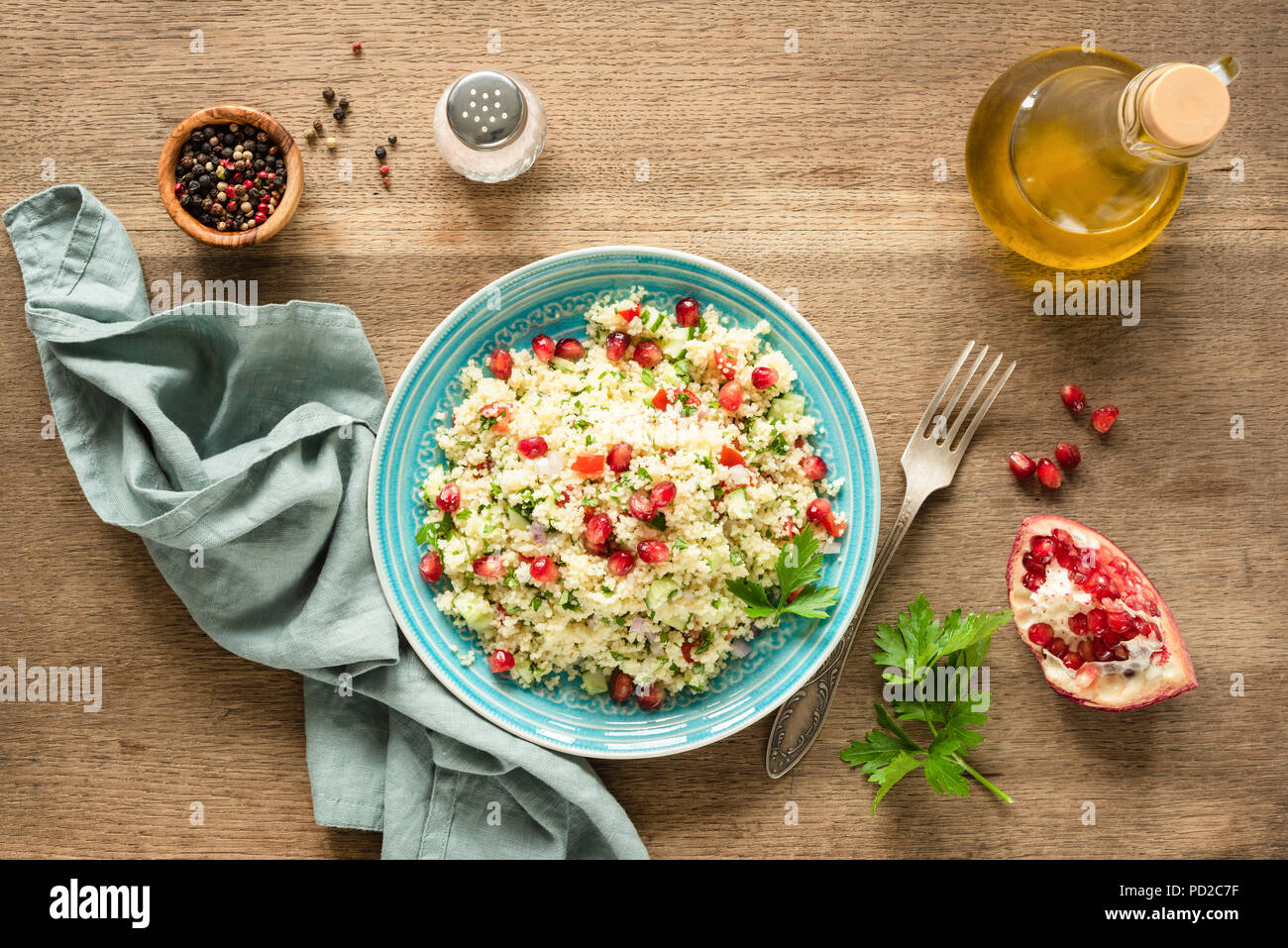 Vegetarian arabic couscous salad Tabbouleh with pomegranate seeds, parsley and olive oil. Top view Stock Photo