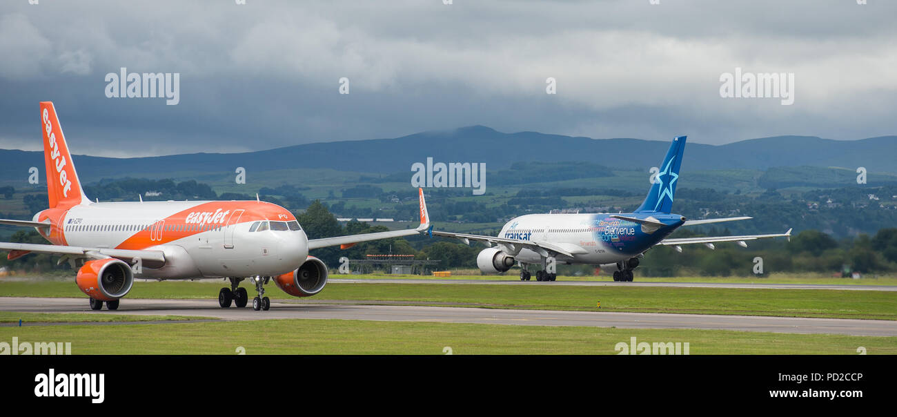 Canadian low cost airline, Airtransat seen at Glasgow International Airport, Scotland - Stock Image