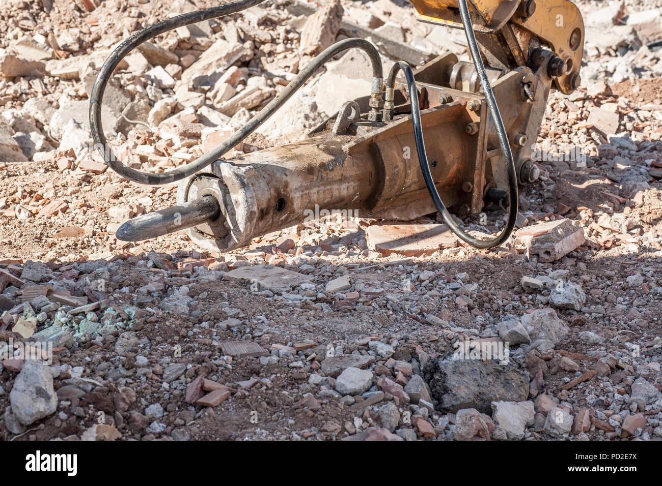 Excavator attachment for drill or jackhammer. Closeup - Stock Image