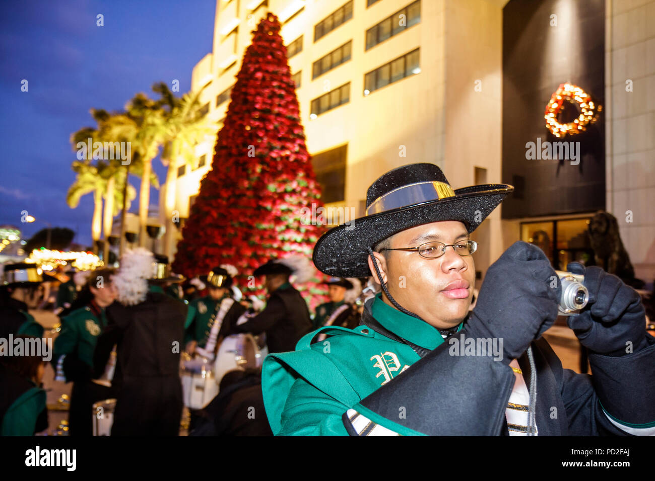 Miami Coral Gables Miami Florida Junior Orange Bowl Parade staging area community family event youth Black boy teen student high schoo - Stock Image