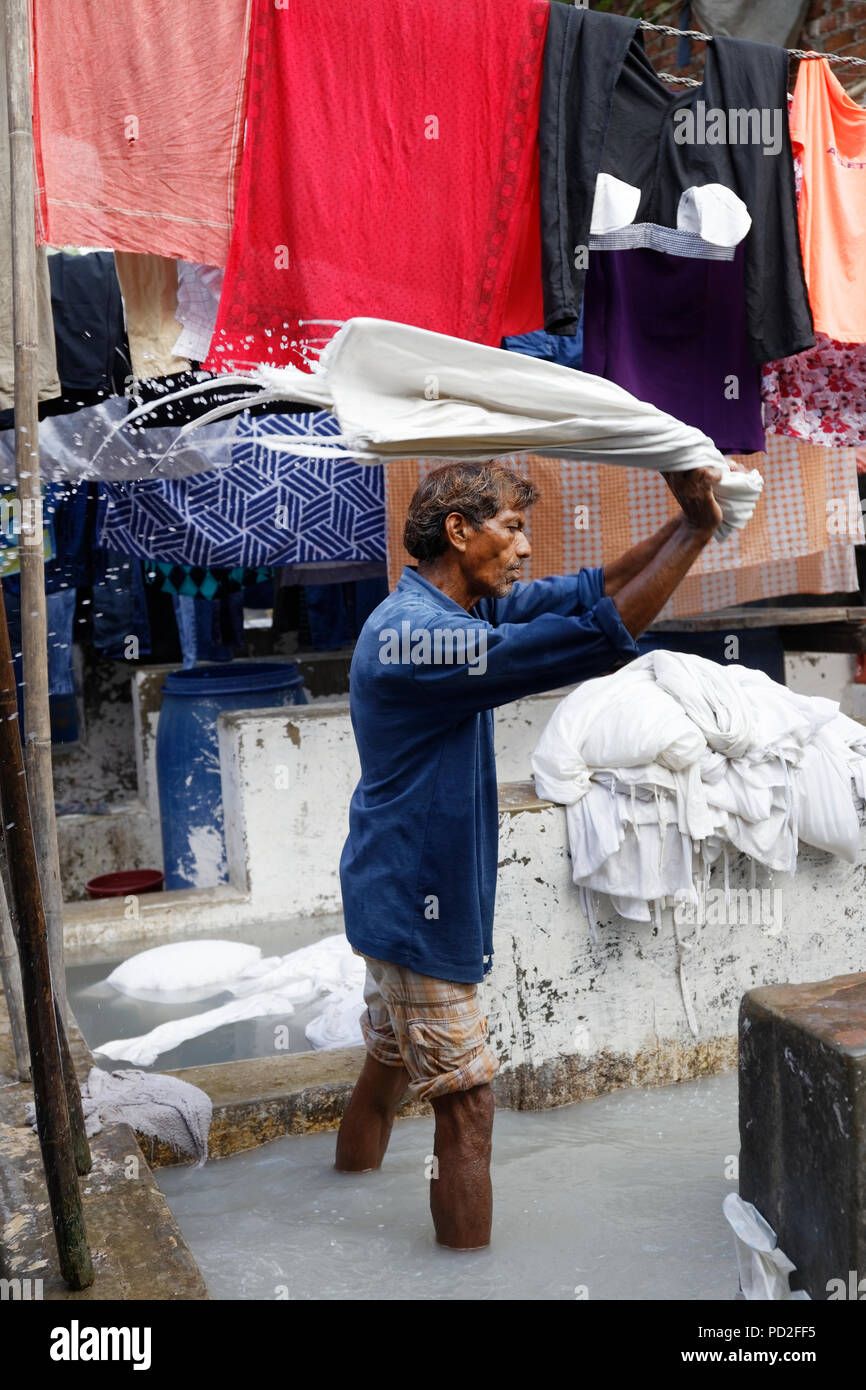 workers in Dhobi Ghat (Mahalaxmi Dhobi Ghat) a well known open air laundromat in Mumbai, India. Stock Photo