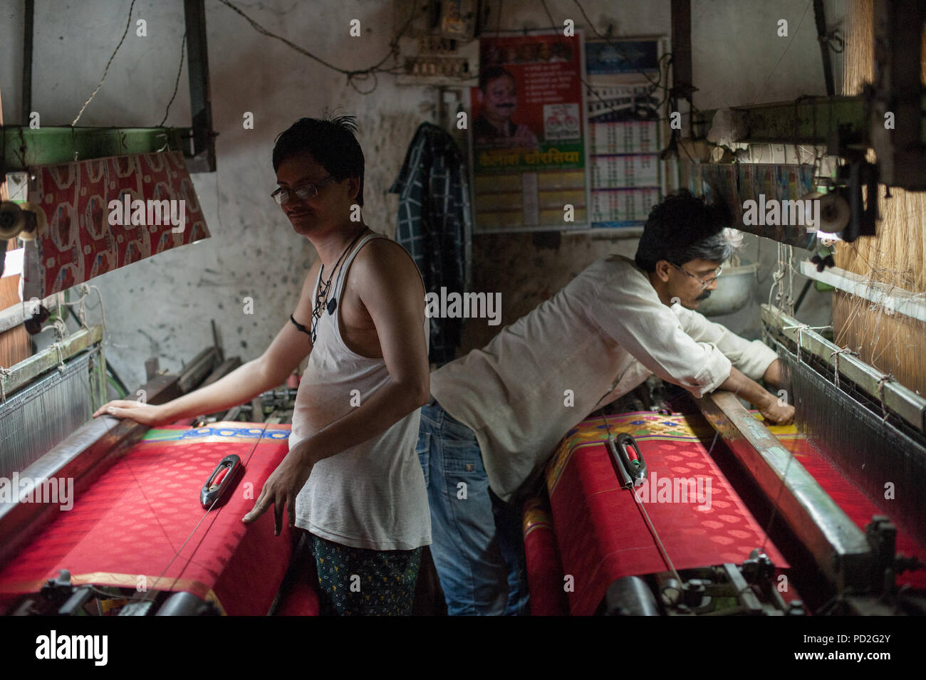 Silk spinning workshops in the weavers district of Varanasi, Uttar Pradesh, India - Stock Image