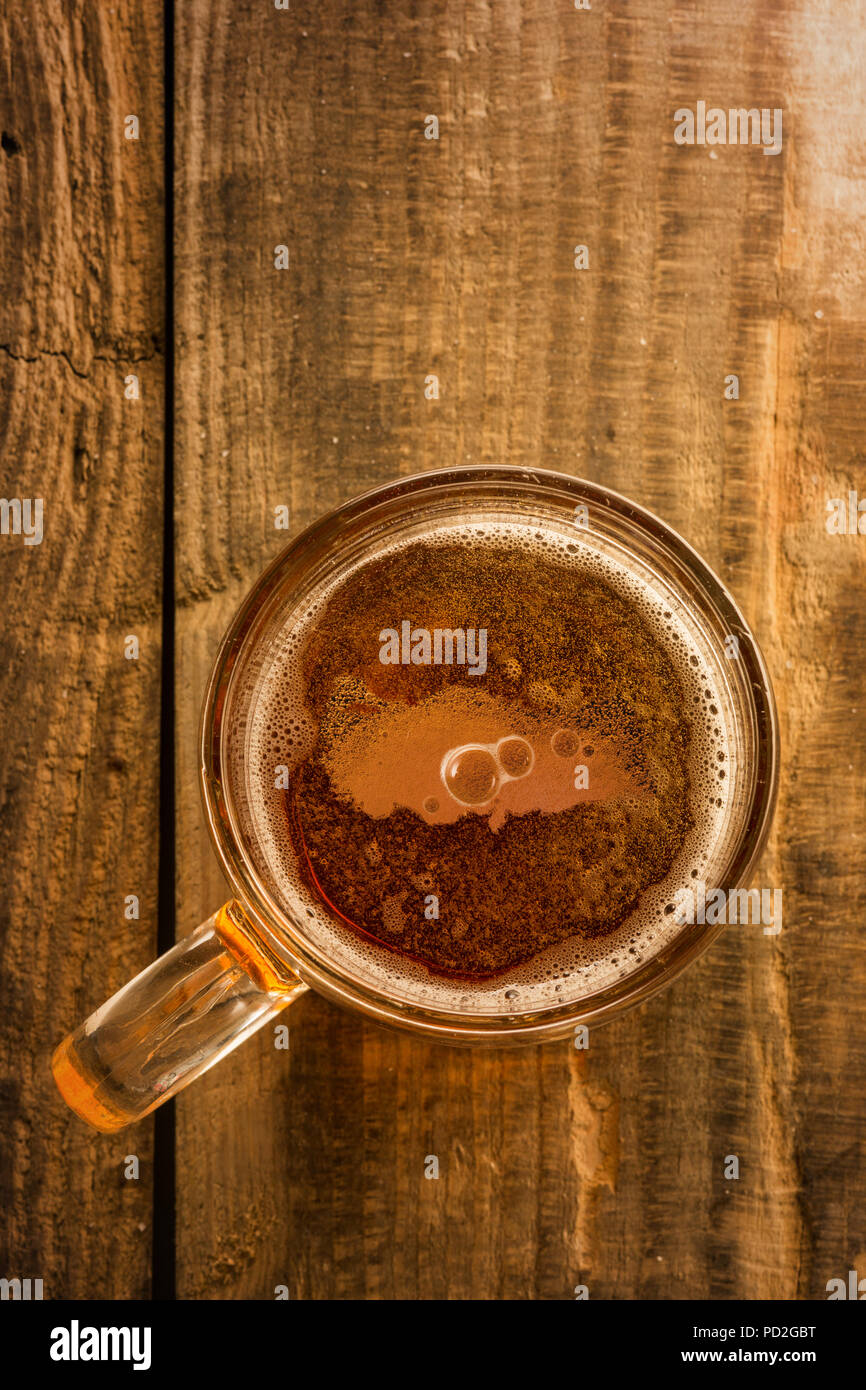 Turkish map and beer concept, Turkey silhouette on foam in beer glass on wooden table. Top view on mug of beer with foam bubbles. The national love of beer concept Stock Photo