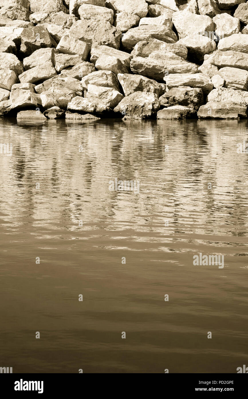 Dam with stone blocks for protection from sea storms - image with copy space - Stock Image