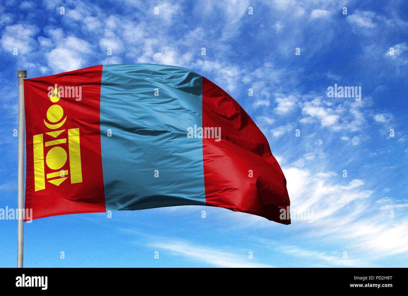 National flag of Mongolia on a flagpole in front of blue sky. - Stock Image