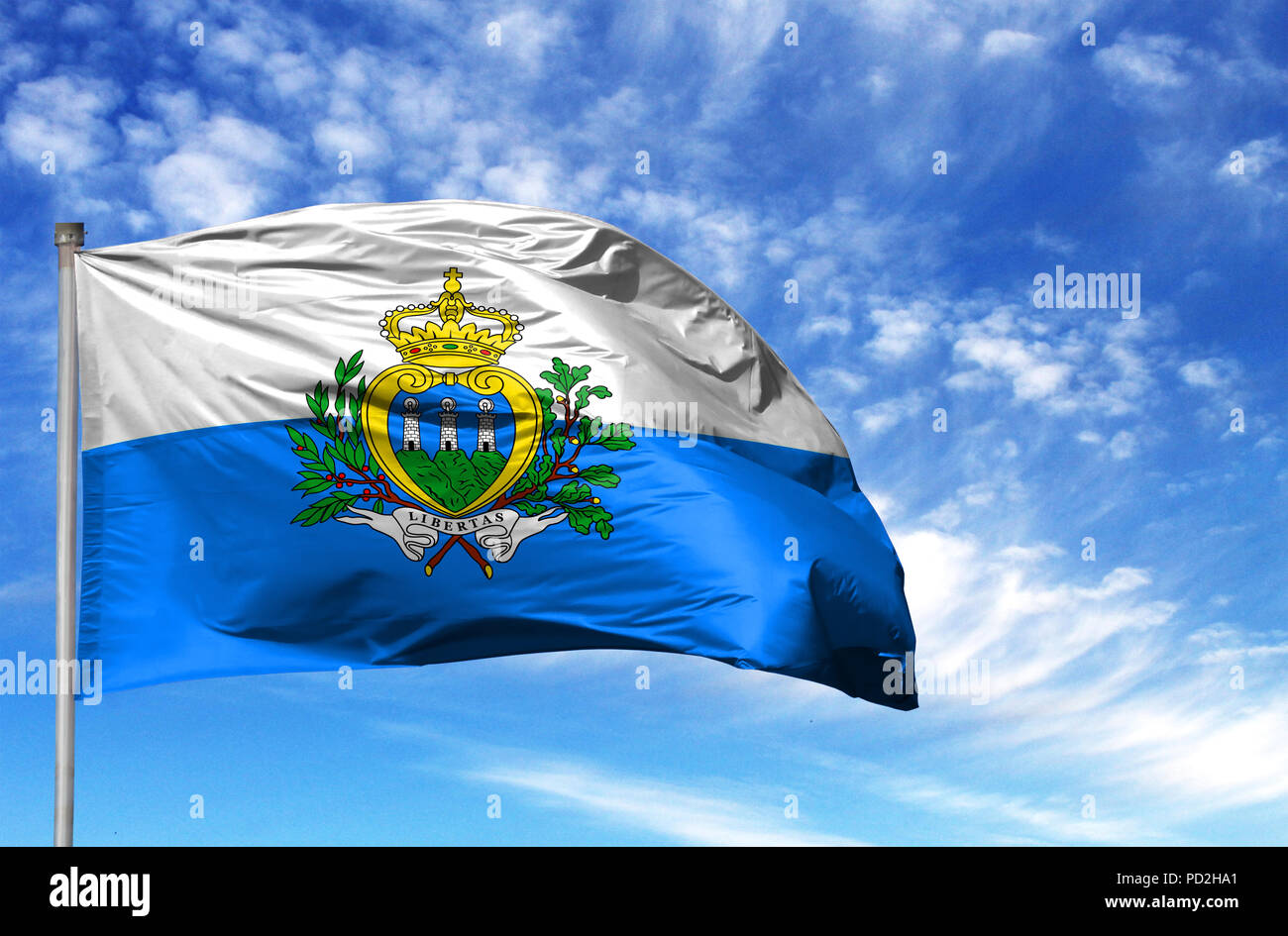 National flag of San marino on a flagpole in front of blue sky. - Stock Image