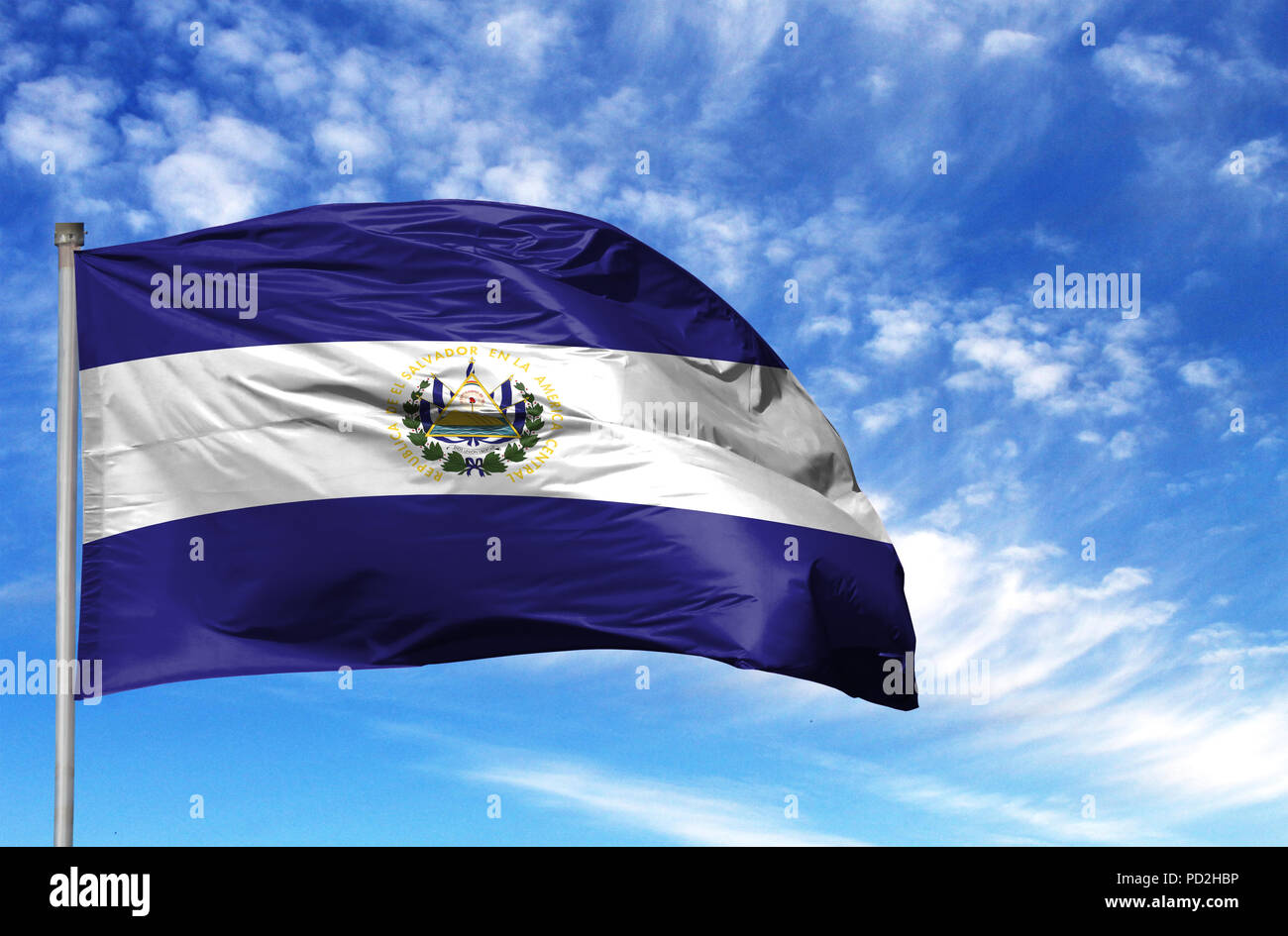 National flag of El Salvador on a flagpole in front of blue sky. - Stock Image