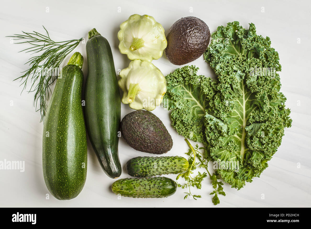 Assortment of green vegetables on white background, top view. Fruits and vegetables containing chlorophyll. - Stock Image