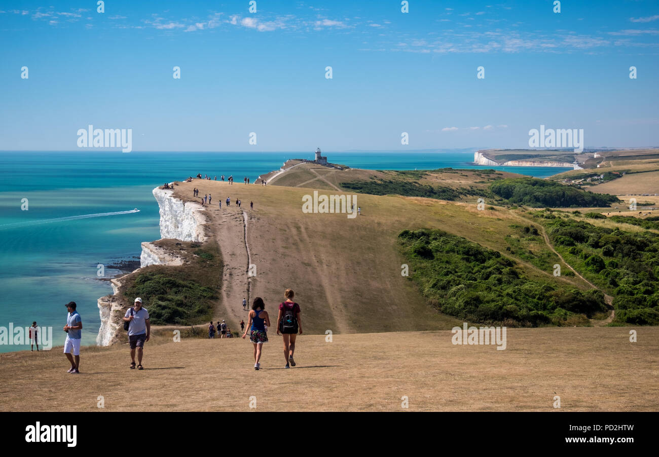 People enjoying the hot and sunny summer weather at Beachy Head in East Sussex, UK - Stock Image
