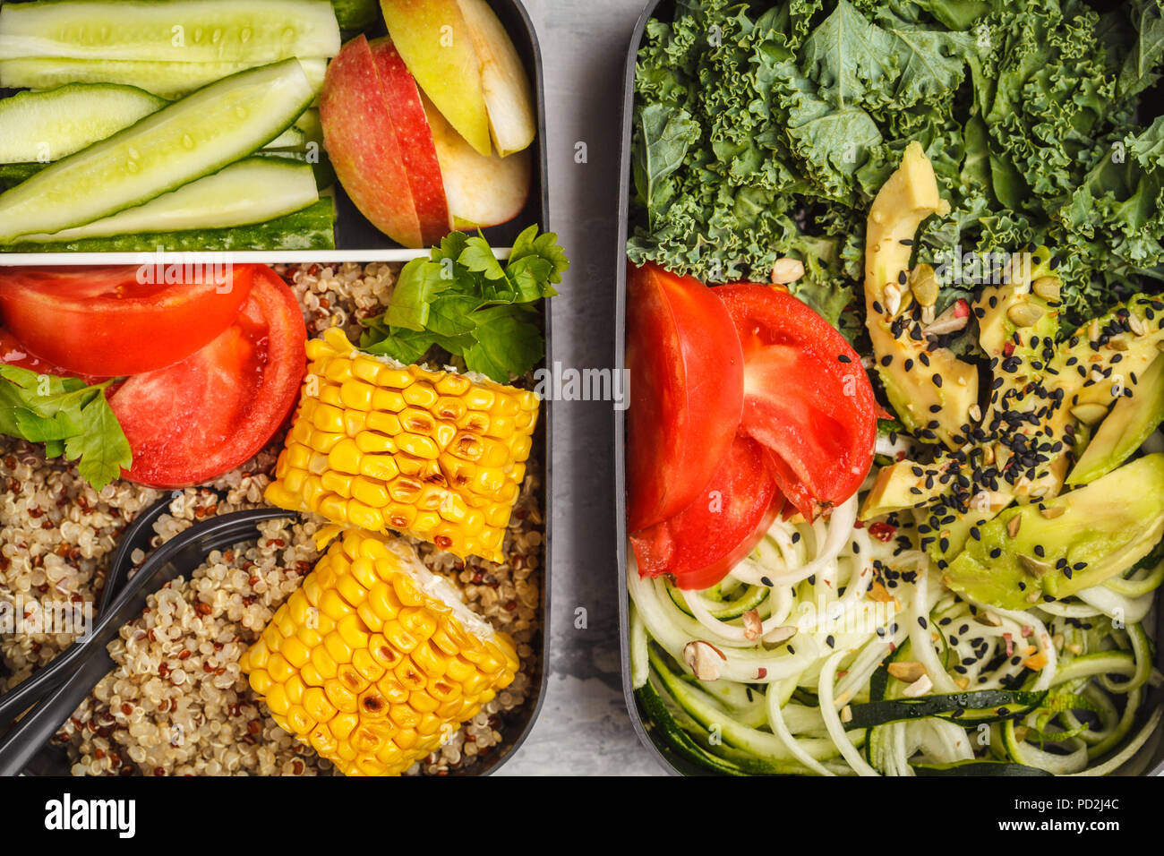 Healthy meal prep containers with quinoa, avocado, corn, zucchini noodles and kale. Takeaway food. White background, top view. - Stock Image