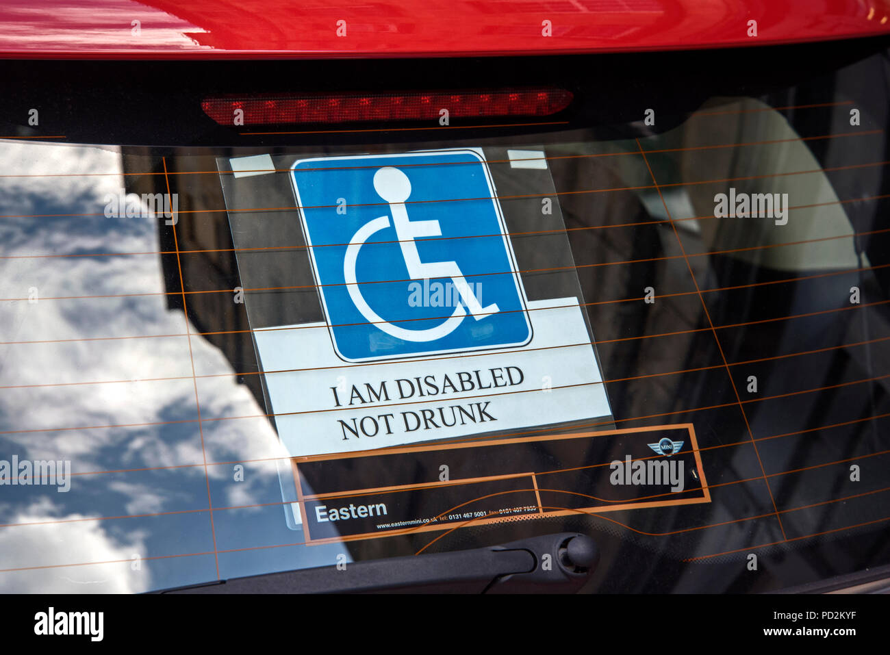 A disabled sticker on a car windscreen with the words, 'I Am Disabled, Not Drunk'. - Stock Image