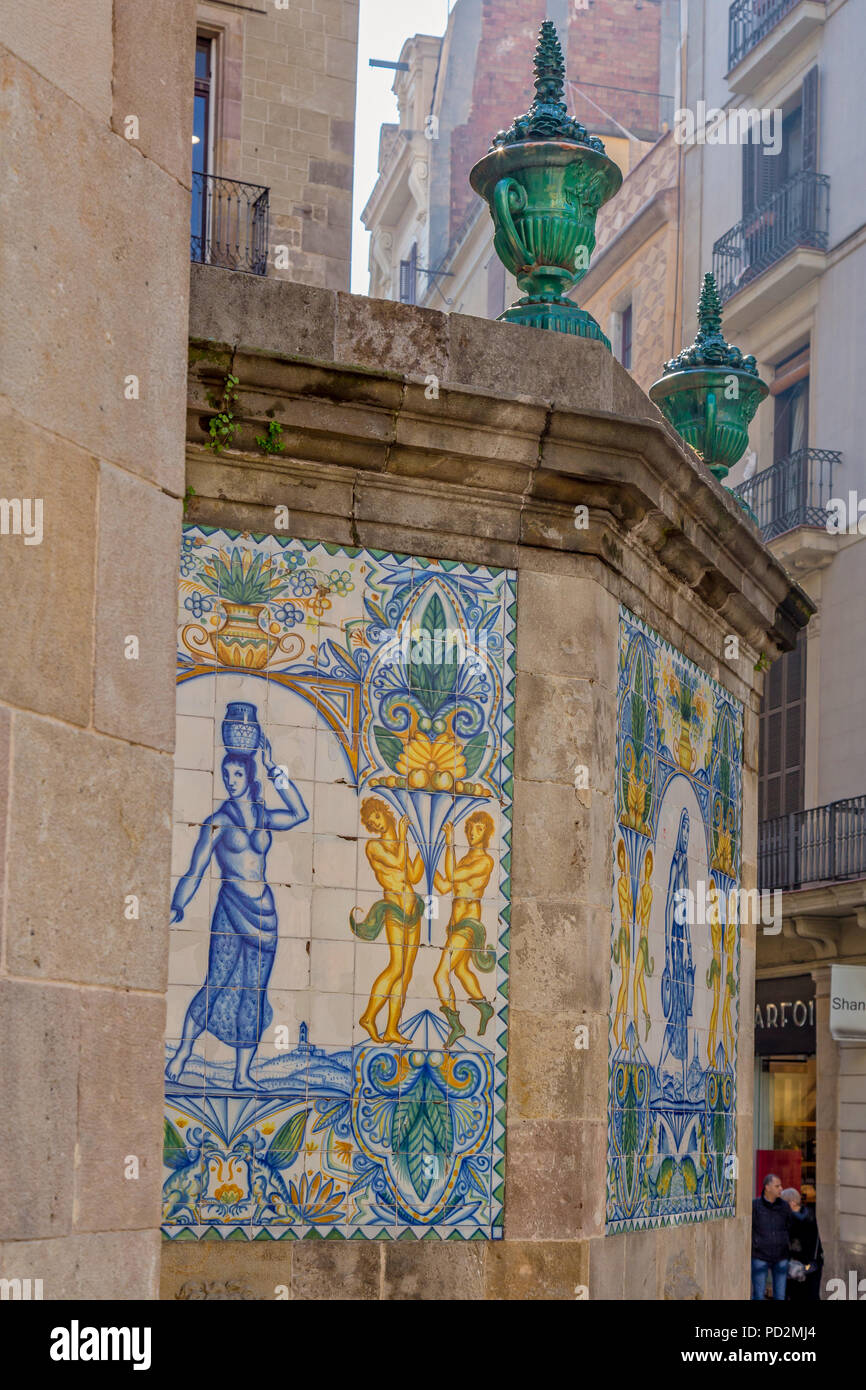 Painted, old ceramic tiles at Santa Ana fountain in the gothic quarter of Barcelona. Stock Photo